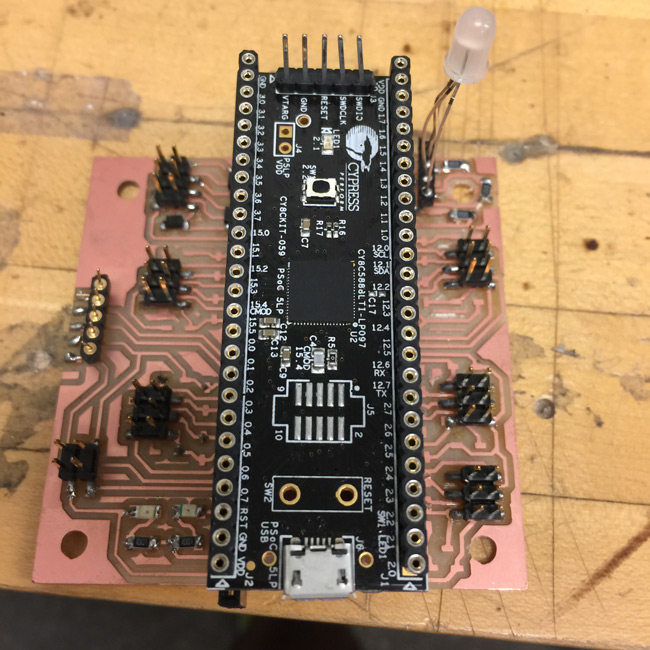 A single Cypress PSoC 5LP was used in each cube and attached via mountings to the circuit board.